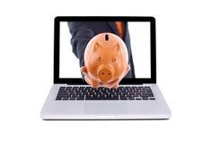 Man holds a piggy bank Stock Photos