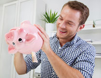 Man holds piggy bank Royalty Free Stock Images