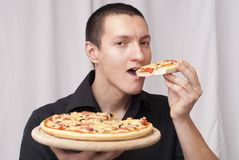 Man is eating pizza royalty free stock image