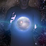 Man holds planet and space Stock Photography