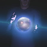 Man holds planet and space in sphere. Between his hands Royalty Free Stock Photos