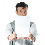 Man holds plate in front of face. Brazilian male wearing neutral Stock Photos