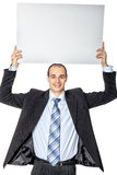 A man holds a poster. Royalty Free Stock Image