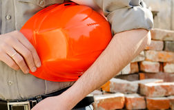Man holds a protective construction helmet Stock Image