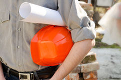 Man holds a protective construction helmet Royalty Free Stock Photos