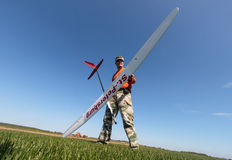 Man holds the RC glider Royalty Free Stock Image