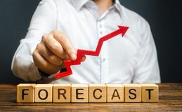 Free Man Holds Red Arrow Up Over Word Forecast. A Budget Surplus, Prosperous Economy Or Company. Prediction Of Profit Growth, Value Stock Image - 158884931