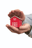 The man holds the red house in a hand Royalty Free Stock Photography
