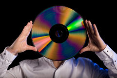 Man holds retro laser disc Stock Photos