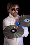 Man holds a retro laser discs Stock Image