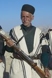 Man holds a rifle circa Isfahan, Iran. Stock Photo
