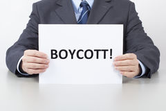 Man Holds a Sheet with a Text Boycott Stock Photography