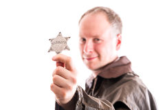 Man holds sheriff badge Royalty Free Stock Photography