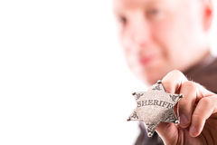 Man holds sheriff badge Stock Photo