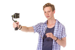Man holds small action camera. Stock Images