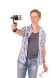Man holds small action camera on gimbal. Isolated on white Stock Photo