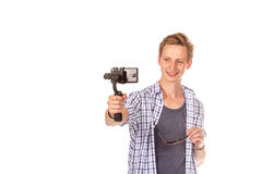 Man holds small action camera on gimbal. Isolated on white Royalty Free Stock Photography