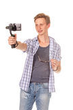 Man holds small action camera on gimbal. Isolated on white Stock Photos