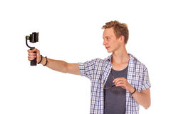 Man holds small action camera on gimbal. Isolated on white Stock Images