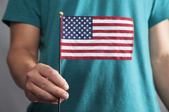 Man Holds Small American Flag Stock Images