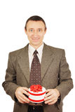 Man holds a small gift with ribbons Royalty Free Stock Photos