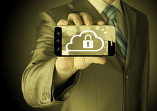 Man holds smart phone with cloud security concept Royalty Free Stock Images