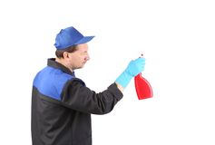 Man holds spray bottle. Royalty Free Stock Images