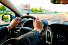 Man holds the steering wheel firmly with both hands Royalty Free Stock Photo
