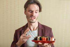 Man holds sushi set Royalty Free Stock Image