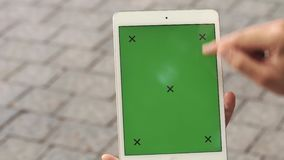 Man holds tablet with green screen stock video footage