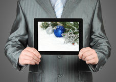 Man holds tablet PC with Christmas composition Stock Images