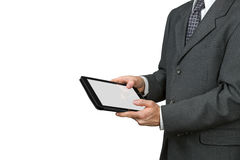 Man holds a tablet in two hands. Royalty Free Stock Photography
