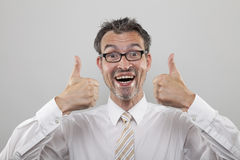 Man holds thumbs up Stock Photos