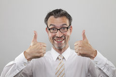 Man holds thumbs up. Happy smiling man hold up thumbs of both hands royalty free stock images