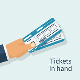 Man holds tickets in hand. Stock Image