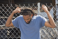 Man Holds to Fence in Ferguson Royalty Free Stock Photography