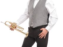 Man in gray waistcoat standing with pipe on his leg isolated on white background. A man holds a trumpet with one hand on her leg, another hand in his pants Royalty Free Stock Image