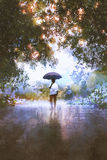 The man holds umbrella standing on the wet road. Digital art of the man holds umbrella standing on the wet road with trees on background, illustration painting Royalty Free Stock Photo