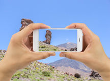 Man holds up camera phone at the Teide Royalty Free Stock Photo