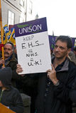 Man holds up a UNISON placard saying Stock Image