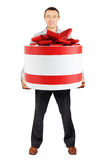 Man holds a very big gift in his hands Royalty Free Stock Photo