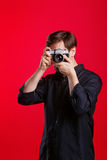Man holds vintage camera. Man holding vintage camera. Photographer takes a photo on a film camera. Man is unrecognizable Royalty Free Stock Images