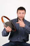 The man holds a wheel in a hand and shows on it a Royalty Free Stock Image