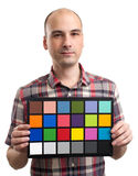 Man holds an white balance card Royalty Free Stock Photography