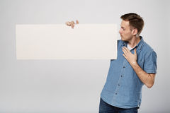 Man holds the white sign in a studio white background Stock Photos