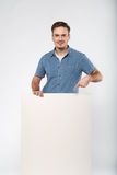 Man holds the white sign in a studio white background Stock Photography