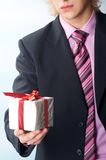 Man holiday a gift on his hand Royalty Free Stock Photos