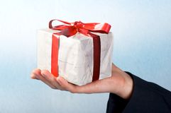 Man holiday a gift on his hand Stock Photography