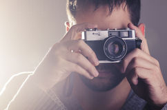 Man holiding retro camera Stock Images