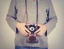 Man holiding retro camera Stock Images